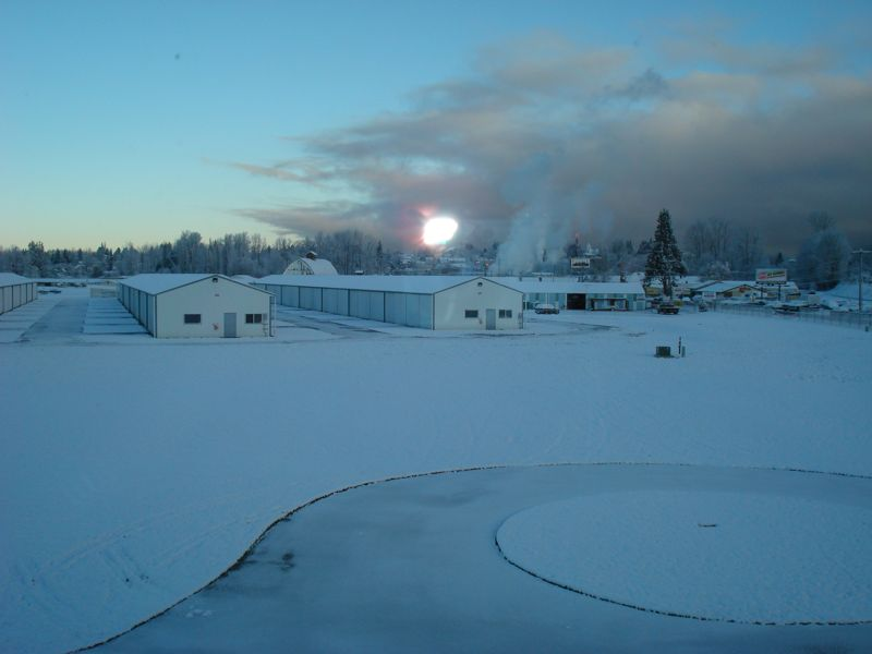Snow covered hangars and buildings